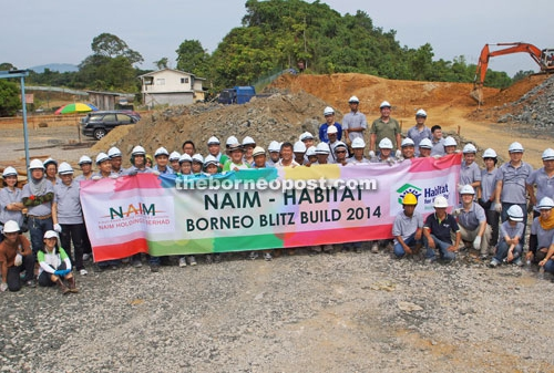 Naim lends muscle to Habitat for humanity
